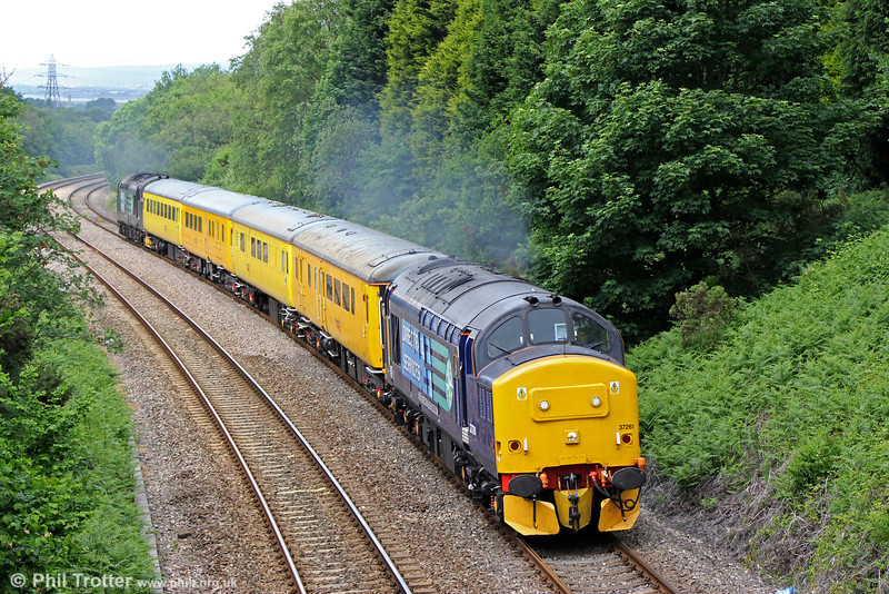 37261 climbs Cockett Bank with neatly turned out test train 1Q13, 0710 Crewe to Landore TMD on 24th June 2013. 37194 was at the rear.