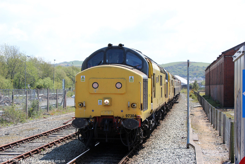 97304 'John Tiley' and 97303 propel the ecs of  Statesman Rail's 'The Welsh Mountain Statesman' out of Aberystwyth to make way for a service train on 25th May 2013.