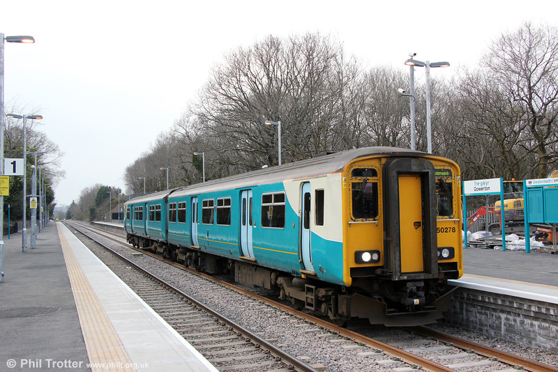 150278 calls at the new-look two platform Gowerton Station forming 2V39, 1405 Shrewsbury to Swansea on opening day, 8th April 2013.