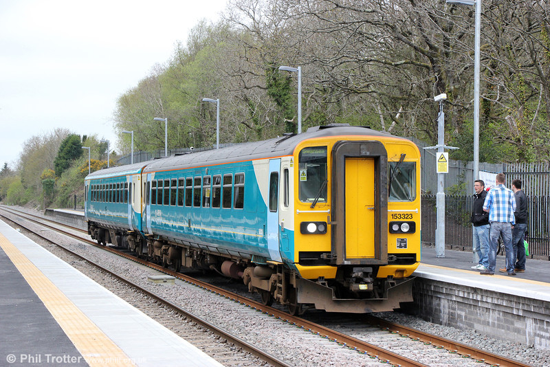 153323 and 153367 call at Gowerton forming 2E05, 0940 Carmarthen to Swansea on 5th May 2013.