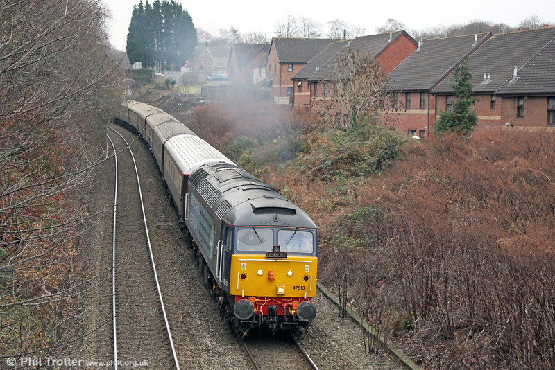 47813 'Solent' passes Cockett with 1Z66, 1208 Cardiff Central to Fishguard Harbour, 'Northern Belle' on 3rd December 2013. 47813 was previously with Cotswold Rail and named 'John Peel'.