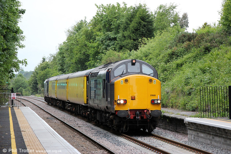 37605 returns through Gowerton with 1Q13, 1810 Landore TMD to Newport ADJ via Llandeilo Junction, Cwmbargoed, Cardiff Bay and Coryton on 11th June 2013