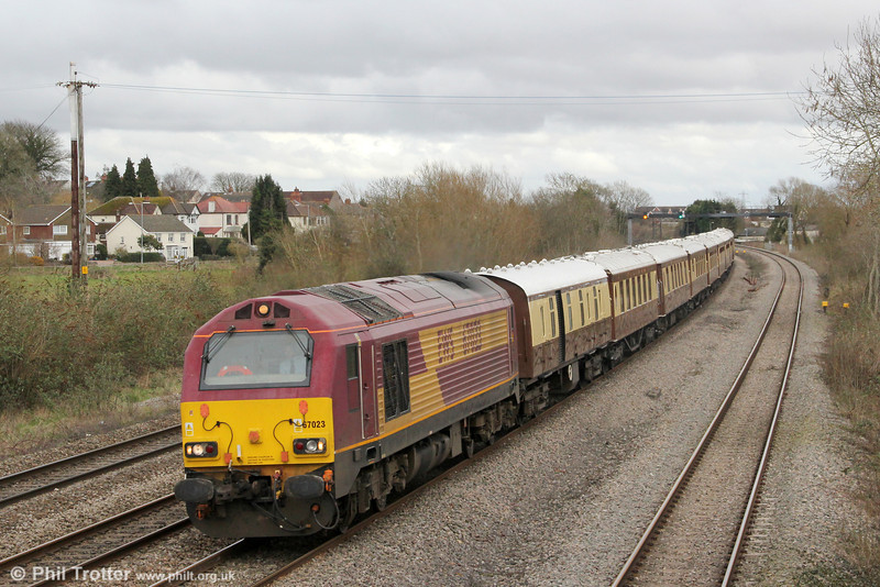 The VSOE vintage Pullman rake is seldom seen in South Wales, except on occasions such as rugby internationals in Cardiff. 67023 passes Magor with 1Z57, 1137 London  Paddington to Cardiff Central 'Rugex' on 16th March 2013.