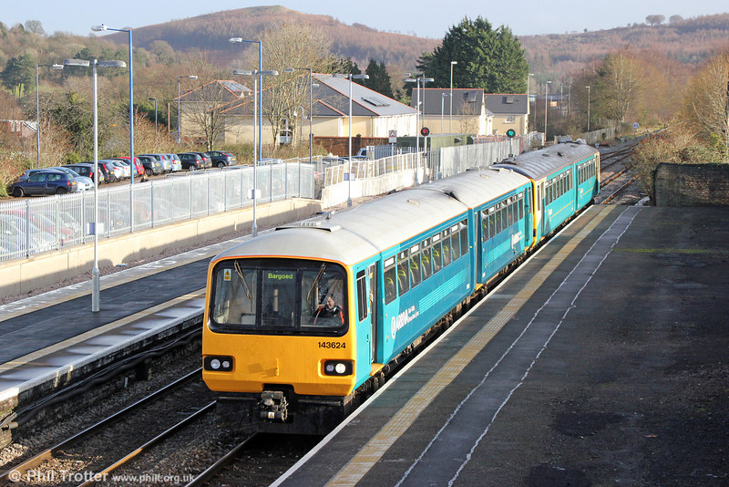 The first ATW class 143 in the new livery is 143624, seen calling at Caerphilly forming 2D36, 1232 Penarth to Bargoed on 31st December 2013. To the left is the new platform which recently has been added as part of the package of capacity enhancements for the Rhymney line.