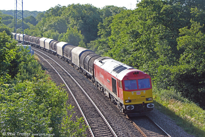 The early morning sunlight catches 60062 'Stainless Pioneer' as it passes Llangewydd with the overnight  6V49, 1934 Tees Yard to Margam on 20th July 2013.