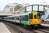 455836 calls at West Brompton with 2O24, 0933 Shepherds Bush to Clapham Junction on 26th June 2013.
