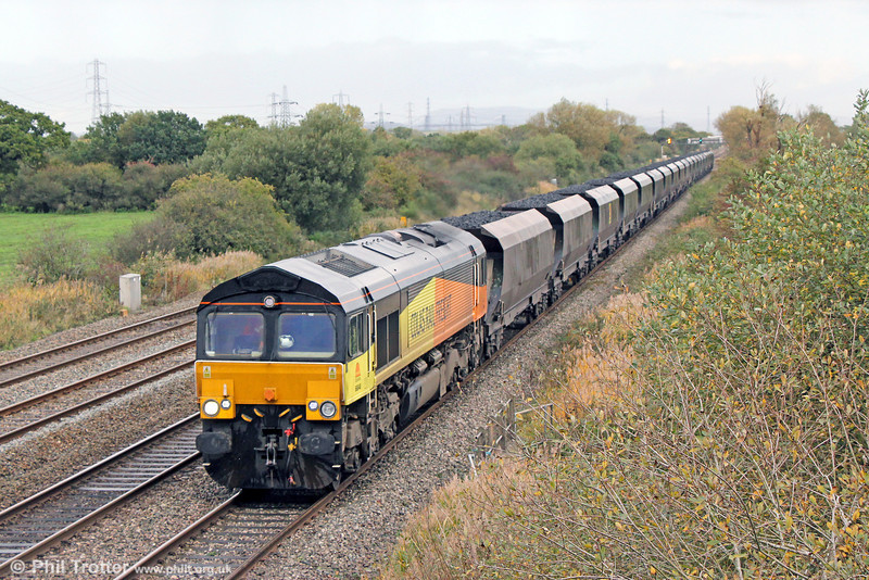 Colas 66848 passes Coedkernew with 6V86, 0935 Derby St. Andrews to Margam Grange coke on 3rd November 2013.