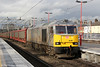 Drax liveried 60066 passes Stafford with 6O42,1131 Halewood (Jaguar) to Southampton Eastern Docks on 28th January 2014.