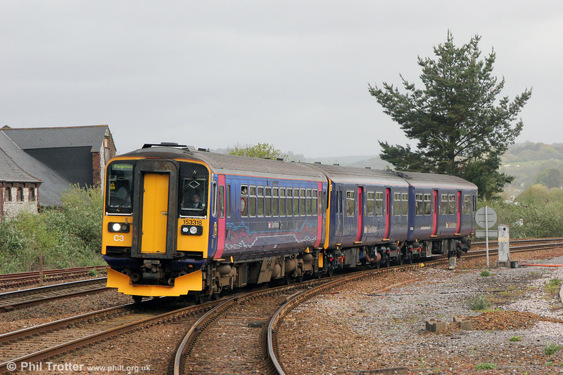 153318 at Newton Abbot leading 2T14, 1024 Exmouth to Paignton on 26th April 2014.