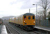NR DTC 9701 leads 1Q14, 0715 Landore TMD to Whitland through Llangennech on 13th February 2014. Power was provided by 97301.