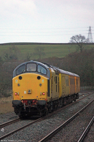 NR 97301 propels 1Q14, 0715 Landore TMD to Whitland through Llangennech on 13th February 2014.
