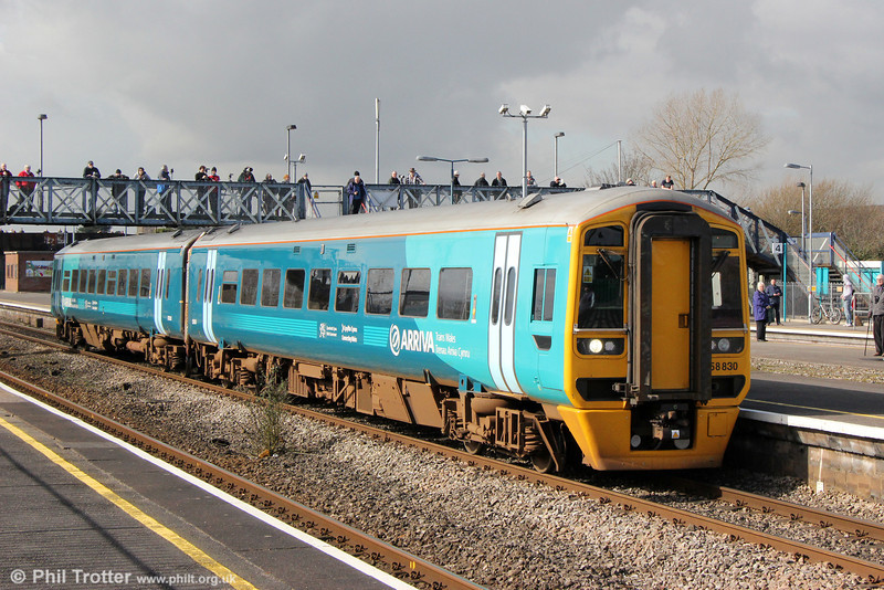 158830 calls at Severn Tunnel Junction forming 2G58, 1115 Maesteg to Cheltenham Spa on 1st March 2014.