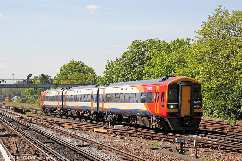 159001 approaches Woking forming 1L38, 1147 Salisbury to London Waterloo on 3rd May 2014.