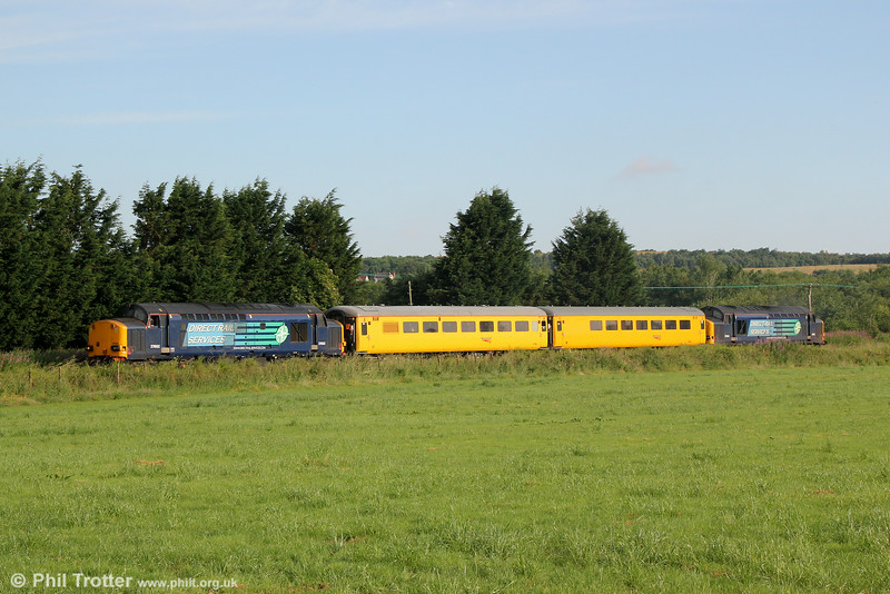 DRS 37602 and 37605 pass Garnswllt with Infrastructure Monitoring train 1Q05, 0549 Landore TMD to Newport on 27th June 2014.