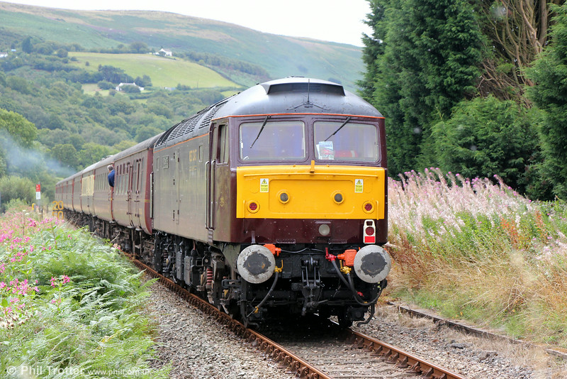 47786 'Roy Castle OBE' at the rear of Compass Tours 1Z56, 0540 Grantham to Cardiff Central, ' The Heart of Wales Scenic Rambler' at Garnswllt on 16th August 2014.