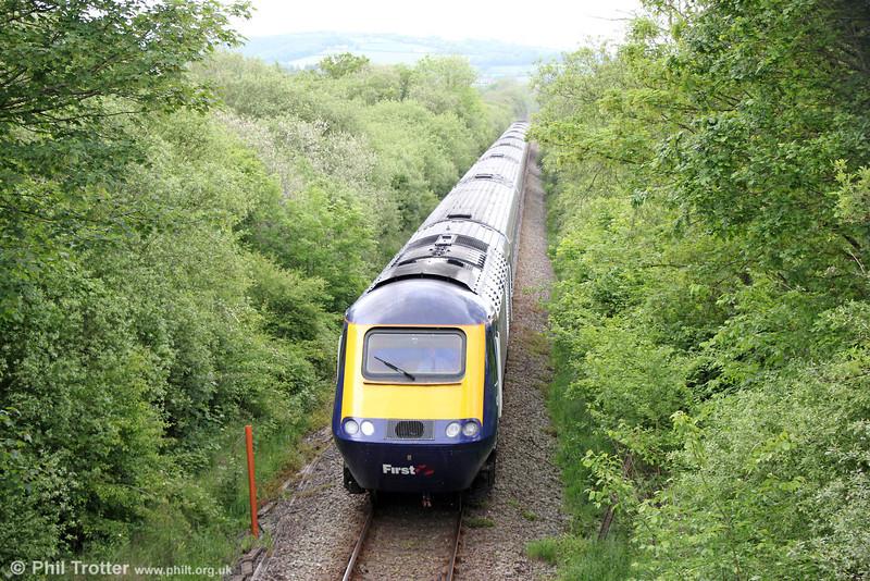 1B15, the 0845 London Paddington to Pembroke Dock passes Llan-Marlais on 31st May 2014.