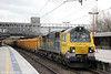 70011 passes Stafford with 6U77, 1342 Mountsorrel to Crewe Basford Hall on 28th January 2014.