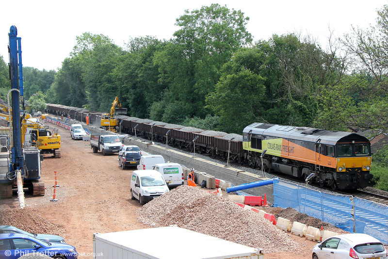 New Ballast is unloaded from 6C27, 0839 from Westbury at the site of the new station at Pye Corner on 1st June 2014.  The train was headed by  66848 with 66846 at the rear.