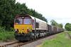66046 passes Garnswllt with 6O70, 1355 Gwaun Cae Gurwen Opencast to Onllwyn on 23rd May 2014.