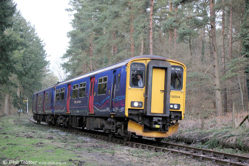 FGW 150244 near Whitecroft forming the 1325 Parkend to Norchard on 22nd March 2014.