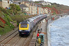 FGW's 1C79, 1106 London Paddington to Plymouth passes along the sea wall at Dawlish on 10th May 2014. Work continues to repair damage sustained during 'The Great Storm' of February. The row of containers mark the point where the line was washed away.