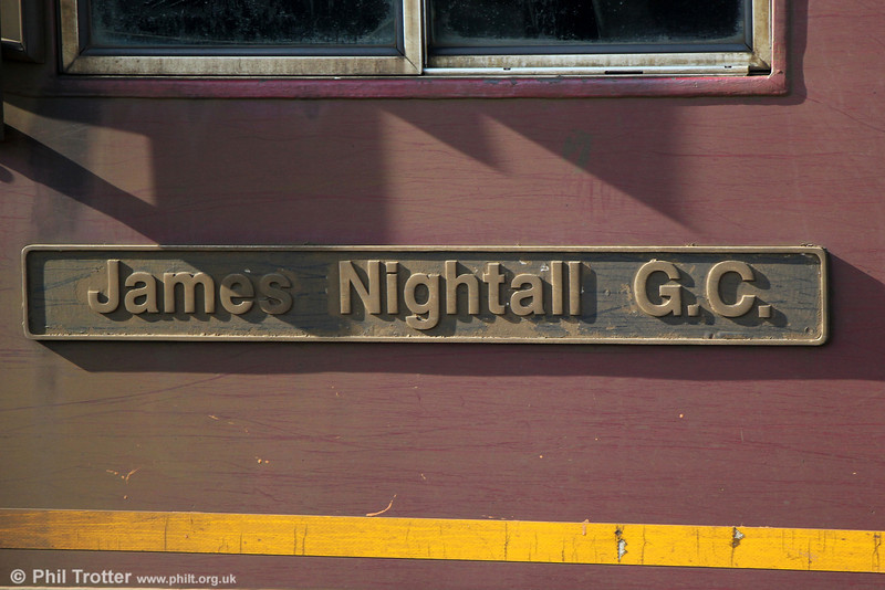 Nameplate of 66079 'James Nightall GC' at Westbury on 8th March 2014. James Nightall GC (1922 - 1944) was posthumously awarded the George Cross for the gallantry he showed during the Soham rail disaster. Nightall was an LNER Fireman on a fifty-one wagon ammunition train driven by Benjamin Gimbert. When a wagon caught fire, Nightall helped Gimbert uncouple it from the rest of the train. The wagon exploded, killing Nightall instantly. The explosion blew a twenty foot crater in the track, destroyed Soham railway station and damaged 600 buildings in the village.