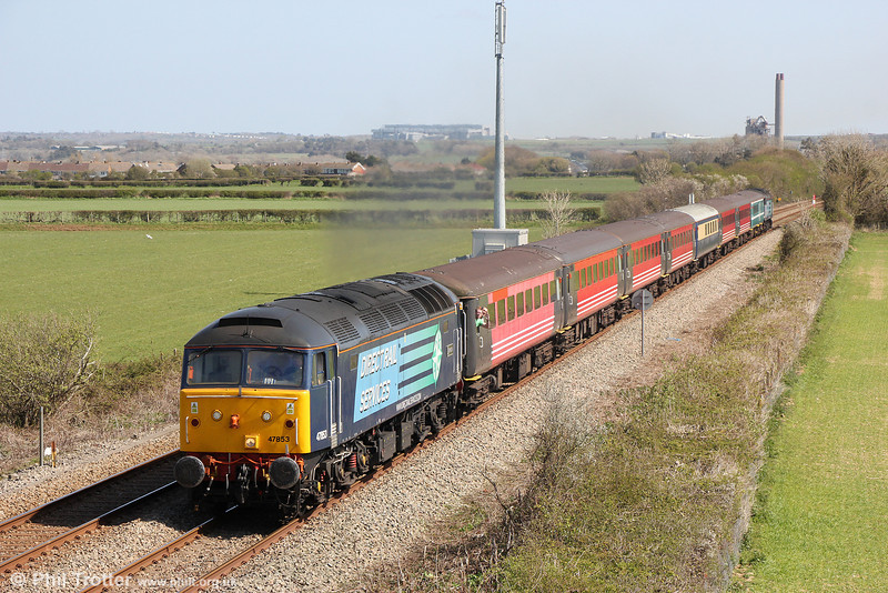 DRS 47853 'Rail Express' passes St. Athan with 1Z68, 1028 London Paddington to Swansea 'Footex' on 13th April 2014. Classmate 47813 'Solent' was at the rear.