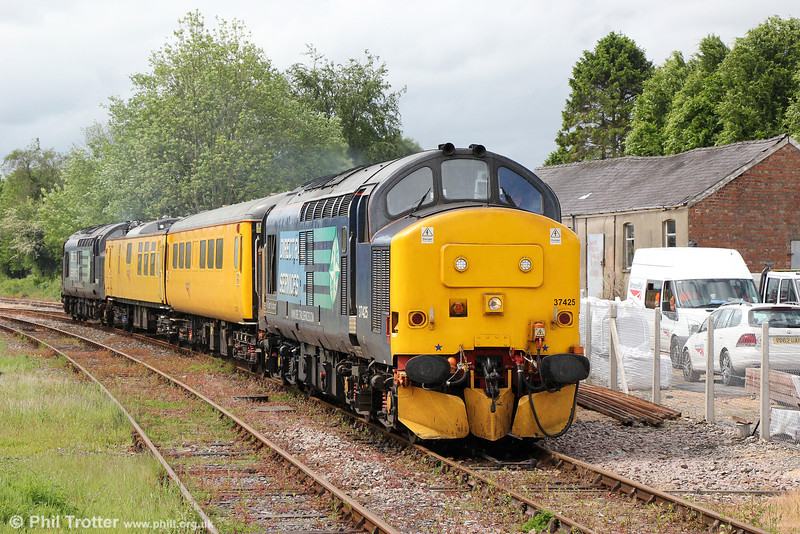 Bob the Builder: 37425 'Sir Robert McAlpine' leads Radio Survey train 1Q14, 0530 Whitland to Crewe into Llandovery on 23rd May 2014. 37667 was at the rear.