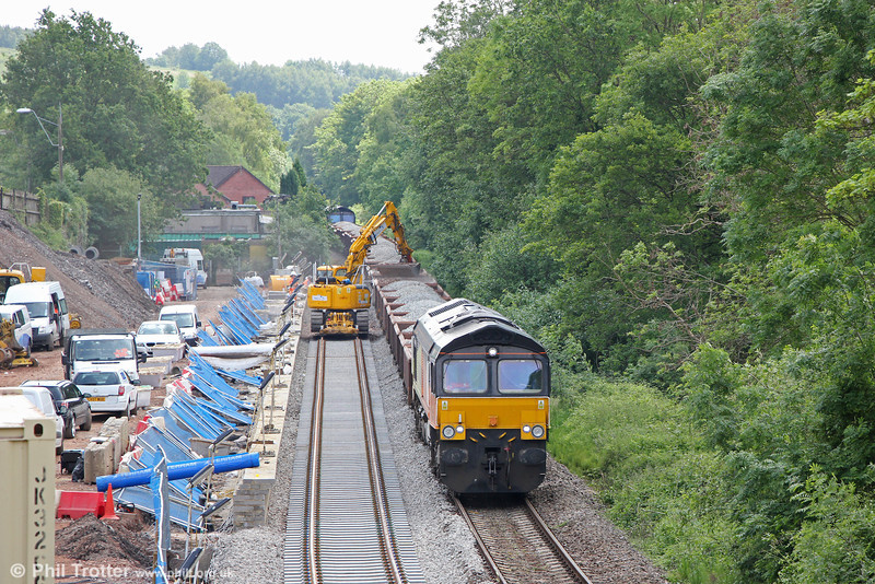 Progress at the new station at Pye Corner on the Ebbw Vale Branch, on 1st June 2014. New Ballast is being unloaded onto the new alignment from 6C27, 0839 from Westbury with 66848 nearest the camera and 66846 at the rear. The existing line on which 66848 is standing will be lifted later. The £3.5M project is due to be completed by the end of the year.