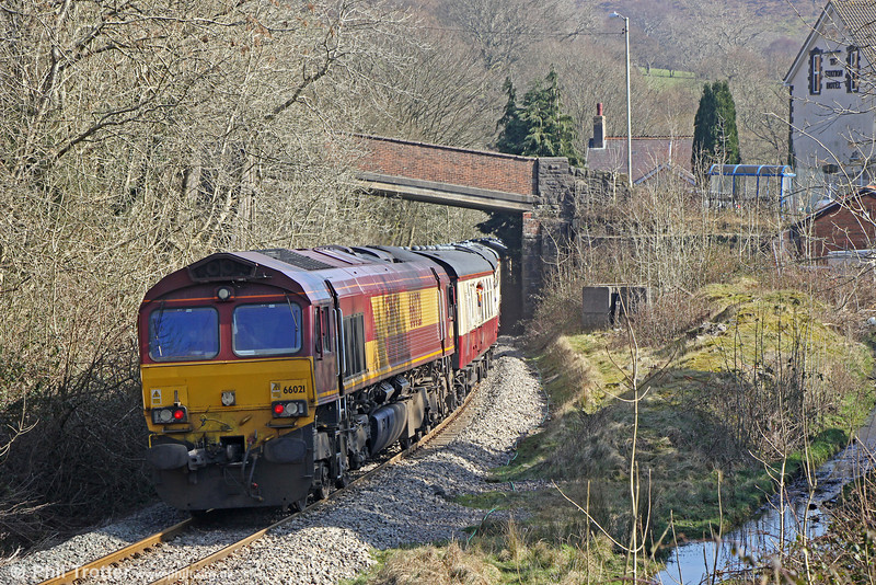 66021 brings up the rear of UK Railtours 1Z63, 1315 Cwmbargoed to Tower Colliery, 'The Tower Gateway' as it passes the site of Bedlinog Station on 9th March 2014. A coal siding once ran from the main line to a point behind the platform (right) roughly on the formation now occupied by the stream. Bedlinog Station closed in June 1964 when the passenger service between Ystrad Mynach and Dowlais was withdrawn.