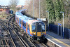 450108 calls at Staines forming 2U38, 1323 Windsor and Eton Riverside to London Waterloo on 16th January 2014.
