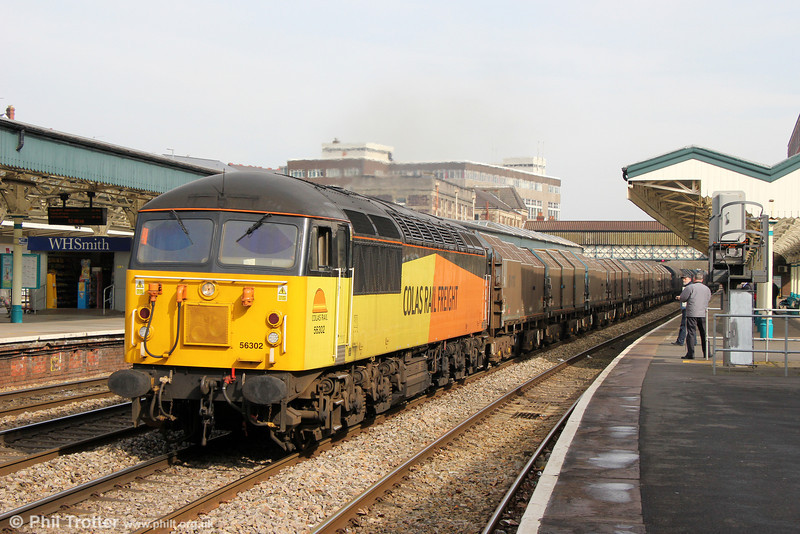 Colas 56302 passes Newport with 6Z43, 1135 Llanwern to Newport Docks on 8th March 2014.