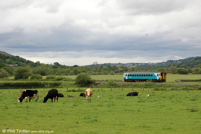 153320 passes Garnswllt forming 2M57, 1312 Swansea to Shrewsbury on 23rd May 2014.