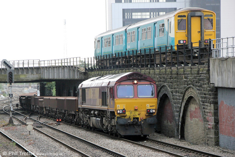 66197 waits at Cardiff East with engineers' train 6W28, which would proceed to Bescot via Margam on 10th May 2014. Overhead, 150267 passes with 2M10, 0726 Barry Island to Merthyr Tydfil.