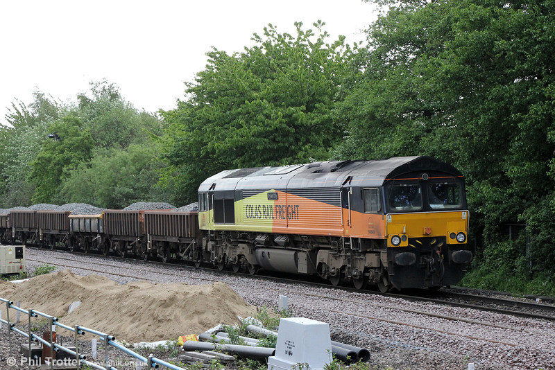 66849 'Wylam Dilly' waits at Pengam with ballast from Westbury on 10th May 2014.