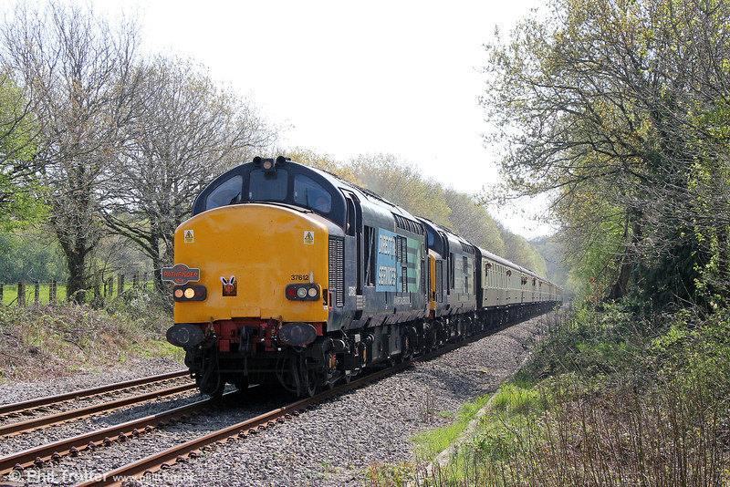 DRS 37612 and 37611 pass Glanlliw with Pathfinder Tours 1Z49, 0707 Eastleigh to Llandrindod Wells, 'The Heart of Wales Meanderer' on 21st April 2014.