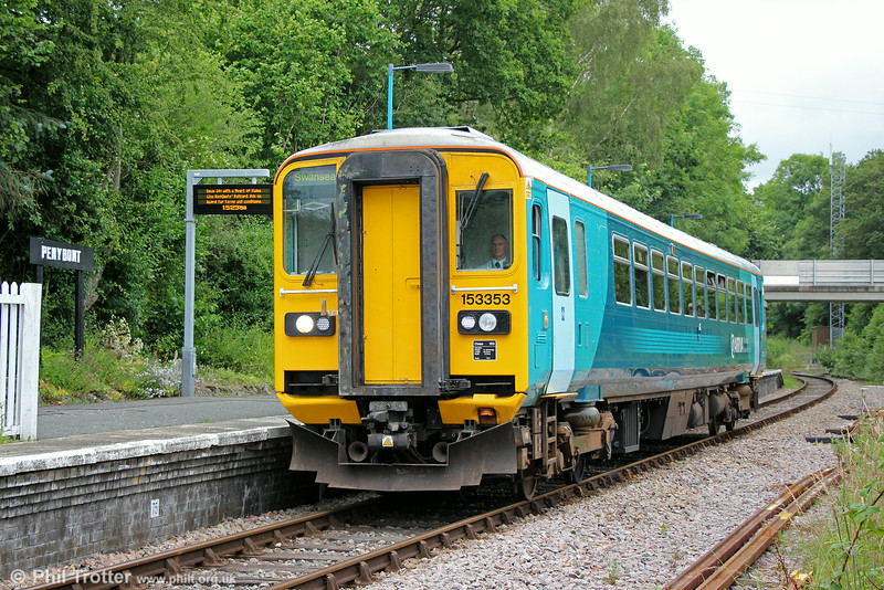 There are to passengers for 153353 as it passes Penybont forming 2V39, 1358 Shrewsbury to Swansea on 12th July 2014.