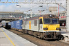 92011 'Handel' passes Stafford with 4M25, 0605 Mossend to Daventry on 16th October 2014.