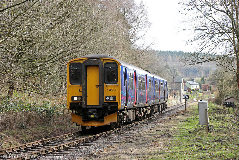 On 22nd March 2014, FGW class 150 150244 spent the day working on the Dean Forest Railway, having earlier formed a special service from Gloucester to Parkend. Here, 150244 pulls away from Whitecroft, forming the 1345 Norchard to Parkend on 22nd March 2014.