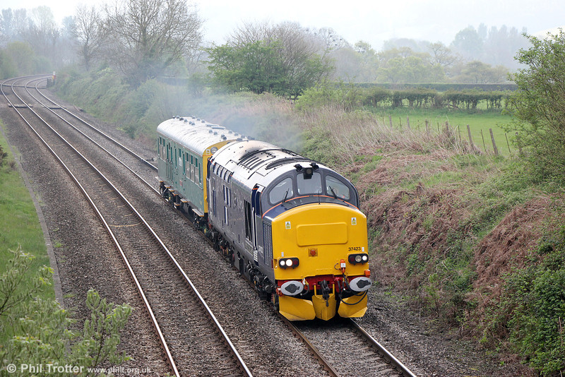 Recently repainted DRS 37423 'Spirit of the Lakes' with inspection saloon 'Caroline' passes Penpergwm with 2Z01, 0850 Newport to Shrewsbury on 28th April 2014.