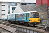 Reliveried 143608 approaches Cardiff Central forming 2E32, 1238 Merthyr Tydfil to Bridgend on 5th March 2014.