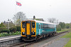 With a Red Kite overhead, 153353 calls at Dolau forming 2M57, 1315 Swansea to Shrewsbury on 21st April 2014.