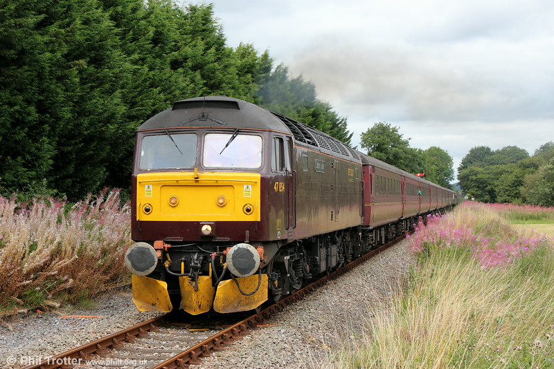 47854 'Diamond Jubilee' passes Garnswllt with Compass Tours 1Z56, 0540 Grantham to Cardiff Central, ' The Heart of Wales Scenic Rambler' on 16th August 2014. Classmate 47786 'Roy Castle OBE' was at the rear. (After a period 'in store' with a painful eye problem which required attention at main works, it's good to be back at the lineside!)