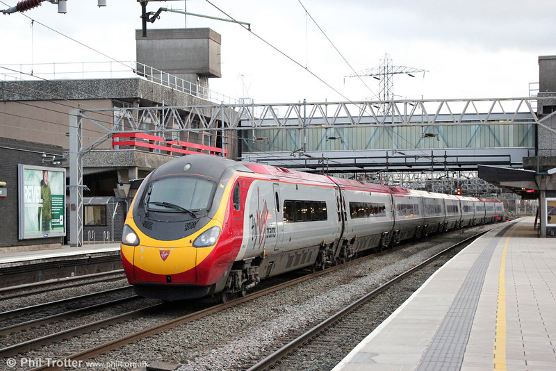 9-car 390005 'City of Wolverhampton' passes Stafford forming 1S71, 1430 London Euston to Glasgow Central on 28th January 2014. Note the 'Fly Virgin Trains' logo.