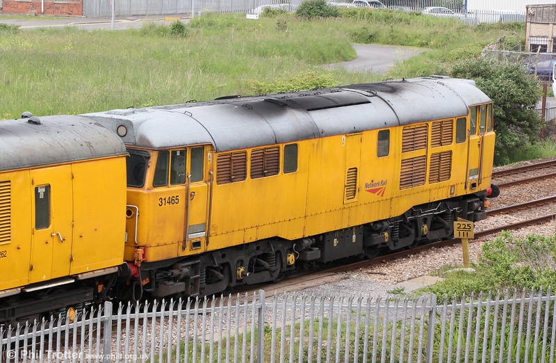 31465 propels 3Q34, 0112 Bristol to Swansea via West Wales branches past Llanelli Dock on 31st May 2014.