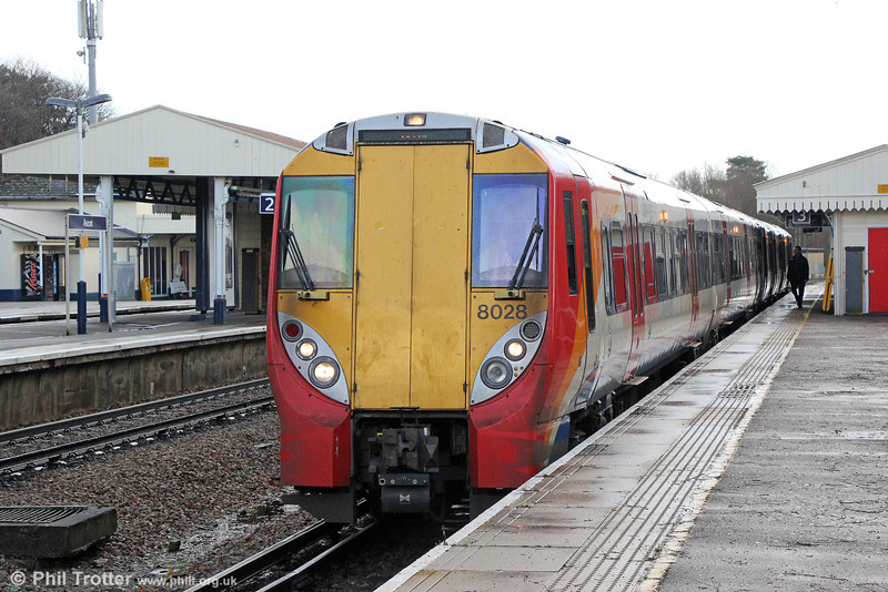 In addition to the Reading to London Waterloo services, class 458 'Junipers' can also be found on Ascot to Guildford workings. 458028 waits to leave Ascot with 2N29, 1223 to Guildford on 16th January 2014.
