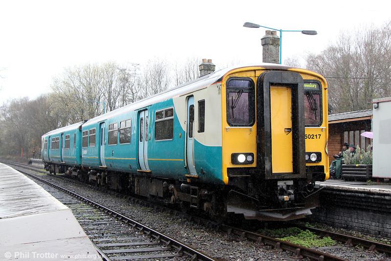 150217 calls at Llanwrtyd Wells forming 2M17, 1315 Swansea to Shrewsbury on 5th April 2014.