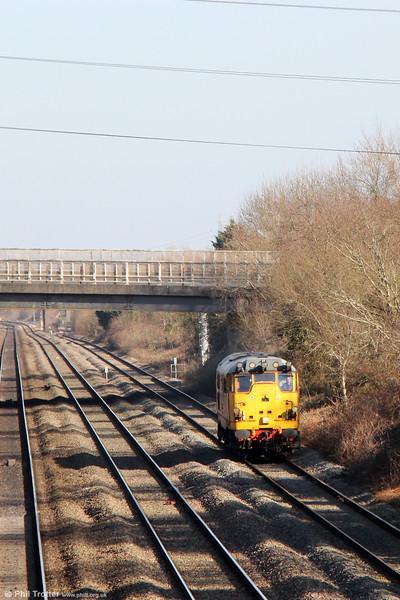 NR 31285 ambles through Llandevenny running as 0Z31, 1115 Derby RTC to Cardiff Central on 7th March 2015.