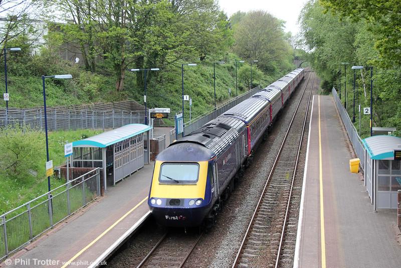 Running 'wrong line' because of over-running engineering works between Skewen and Llansamlet, 43138 heads 1L46, 0942 Swansea to London Paddington through Skewen on 10th May 2015.