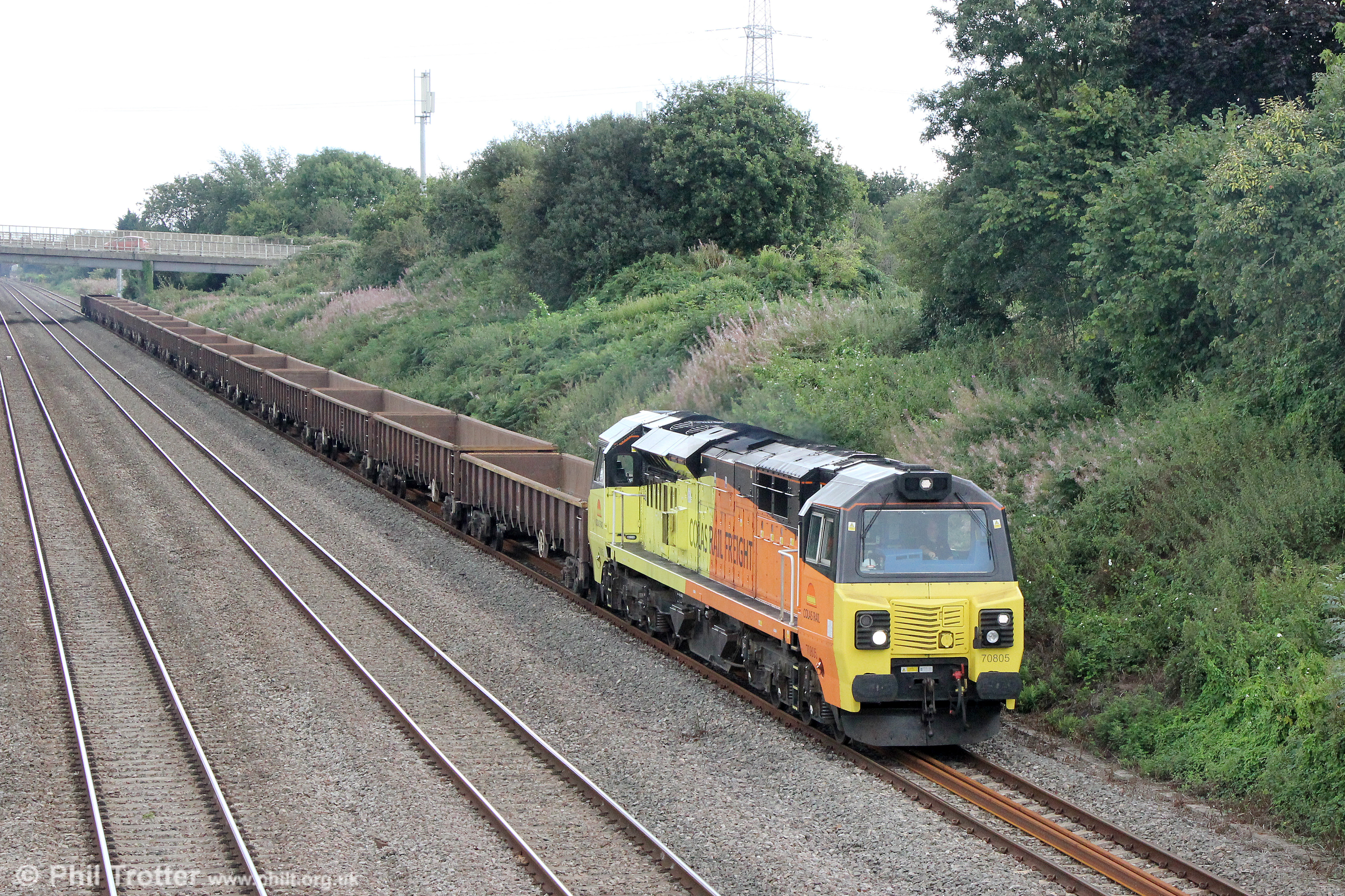 Colas 70805 passes Llandevenny with 6C24, 0959 Bescot to Severn Tunnel Junction on 28th August 2016.